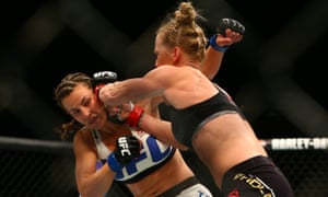 Holly Holm moves in with a punch against Miesha Tate
