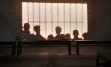 The shadows of schoolboys are seen on a classroom wall in Karachi