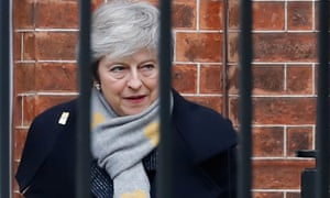 Theresa May pictured behind railings