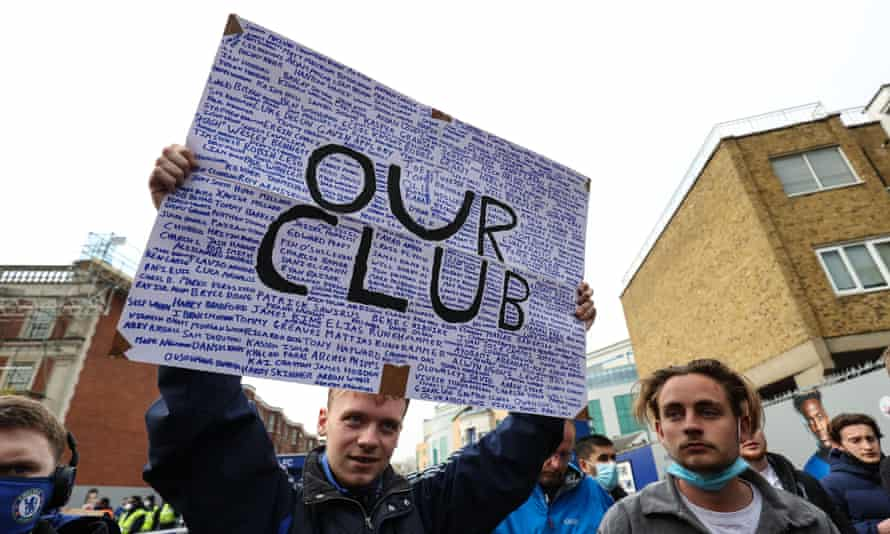 Chelsea fans gather to protest the introduction of the European Super League before the game against Brighton