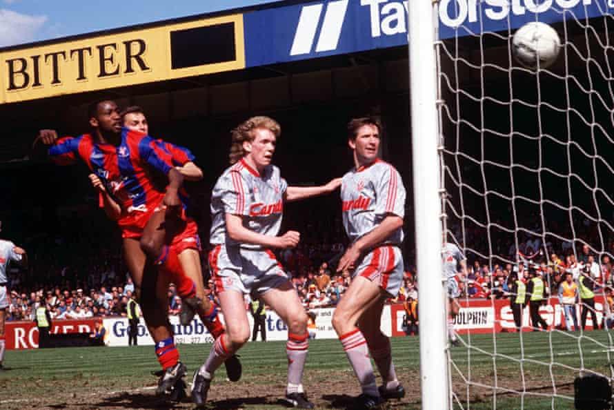 Andy Gray beats Steve Staunton and Whelan to head Palace's third goal.