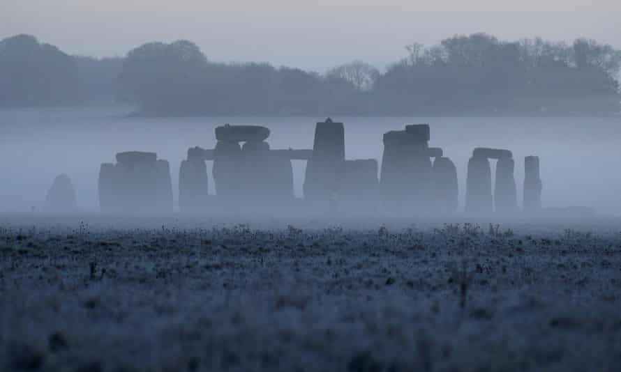 Stonehenge through the mists at dawn