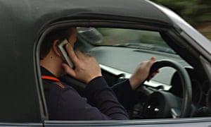 man on mobile while driving