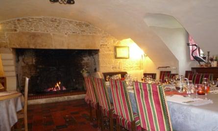 The vaulted dining room at Le Manoir de la Rivière, Normandy, France.