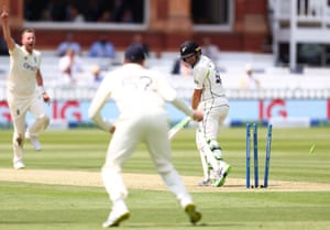 Tom Latham of New Zealand is bowled by Ollie Robinson of England.