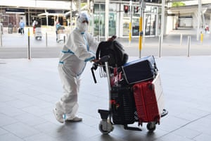 An international traveller dressed in protective clothing arrives the Sydney international airport.