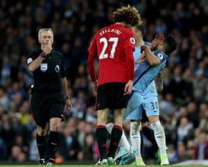 Fellaini headbutts Aguero in front of referee Martin Atkinson.