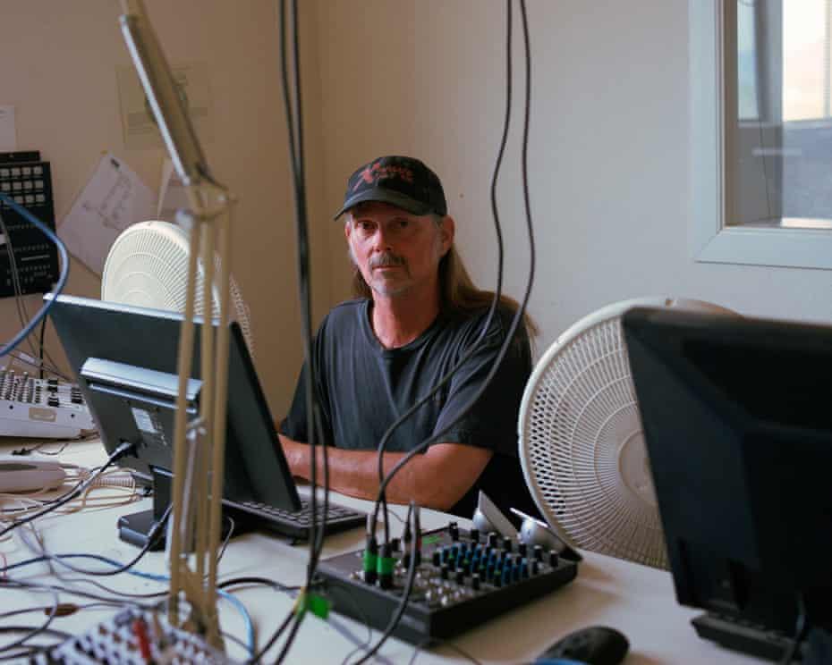 Portrait of Mark Lucke inside the radio station in Willcox, Arizona.