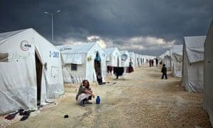 Syrian refugees seek shelter In Turkish camps.