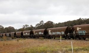A coal train travelling across train tracks near the Wallerawang power station in NSW.