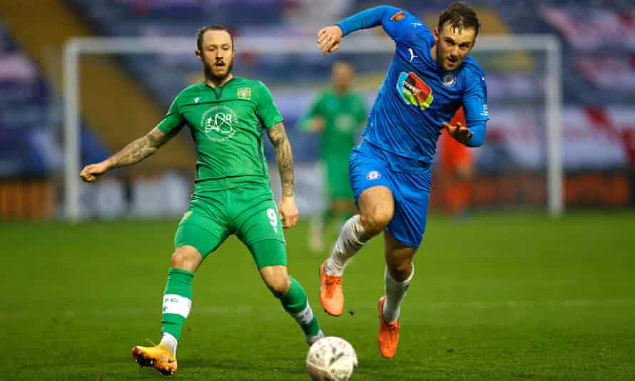 Stockport's Jamie Stott competes with Rhys Murphy of Yeovil Town during Stockport's win in November, which set up Monday's tie with West Ham.