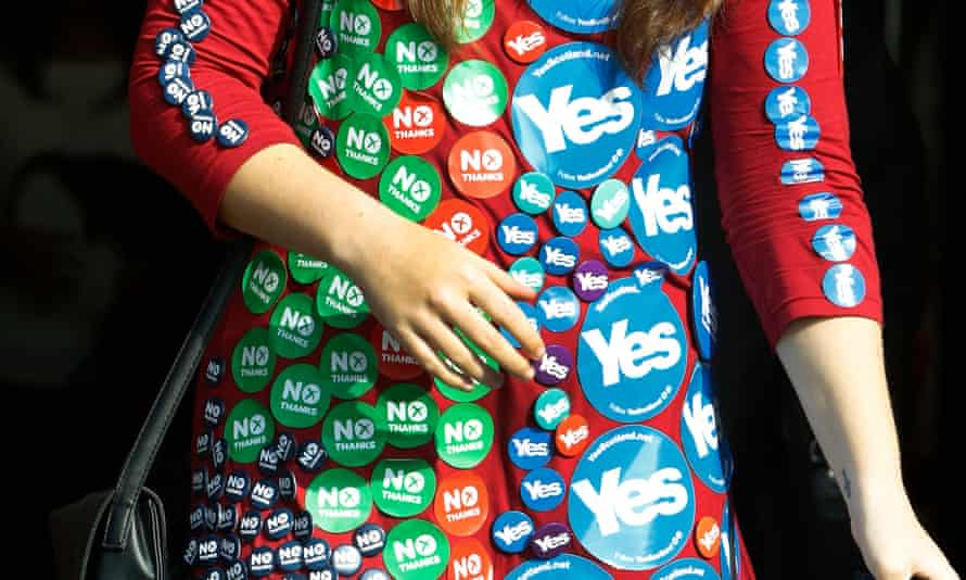 Reporter wearing badges during the Scottish independence referendum in 2014