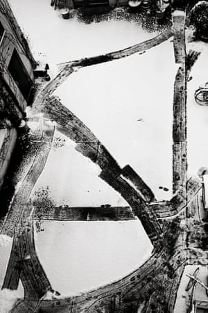 Julia Baier, Untitled, 2014 Through large format, abstracted imagery, such as this shot of a simple courtyard in Berlin, she confronts the viewer with the painterly, formal possibilities photography can still offer.