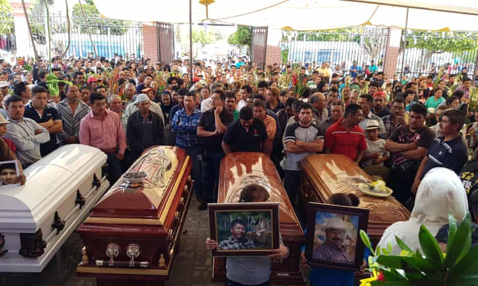 Relatives and friends of four people killed in a clash with soldiers participate in a funeral mass in Palmarito Tochapan, Puebla, Mexico, on 7 May 2017.