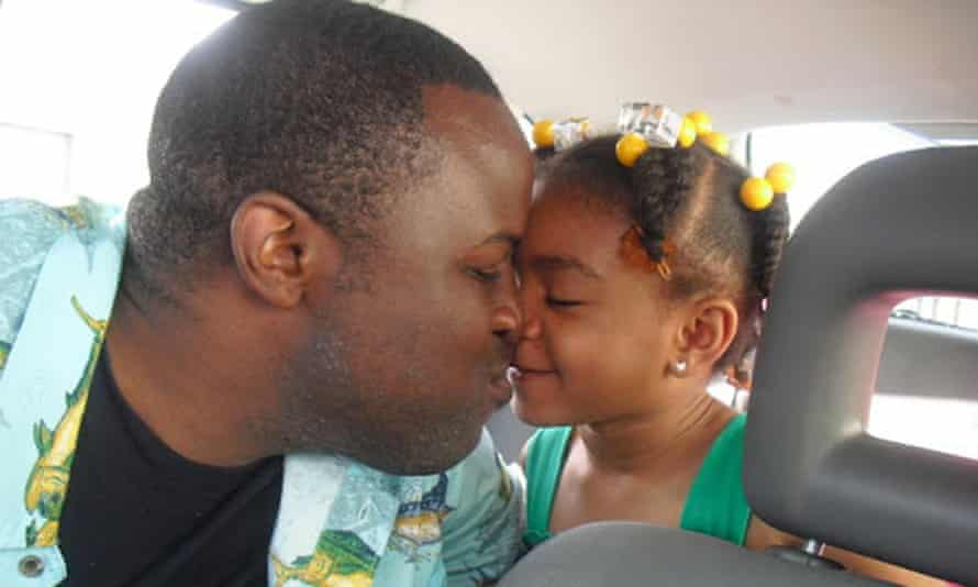 Chinedu Okobi with his daughter. Okobi died after being tased by officers this month.