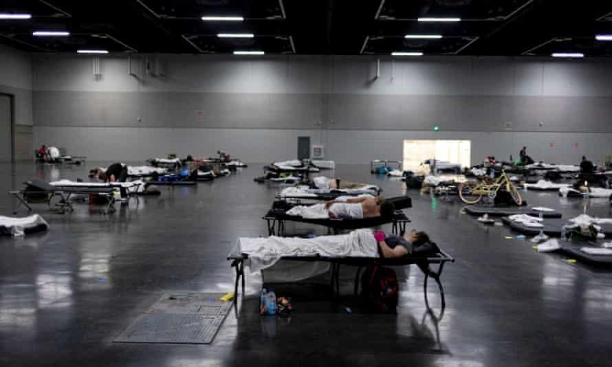 People sleep at a cooling shelter set up during an unprecedented heatwave in Portland, Oregon, 27 June.