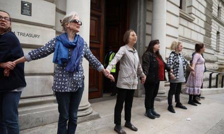 Extinction Rebellion glued together outside the Treasury