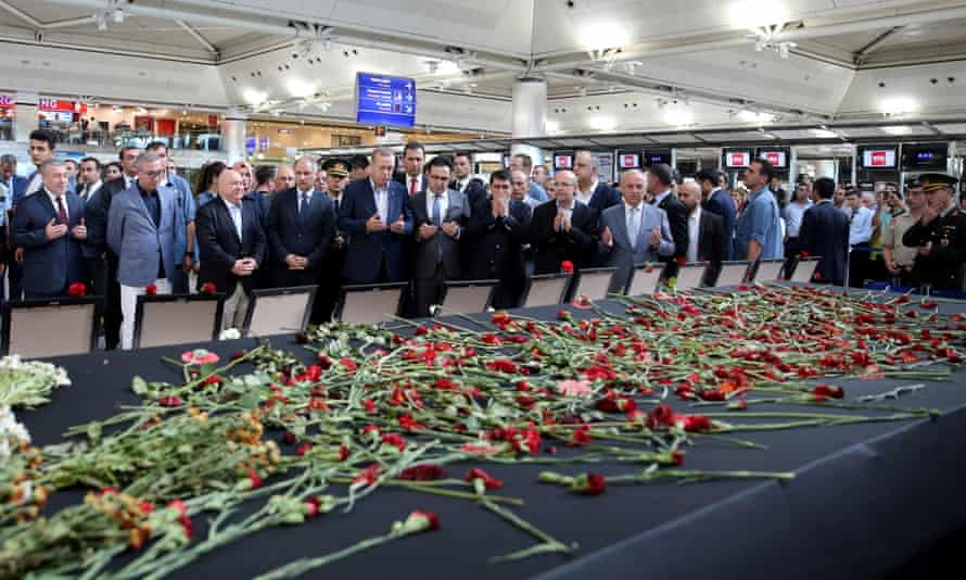 Turkish President Erdogan prays for the airport employees who were killed in Tuesday's attack on Ataturk airport in Istanbul.