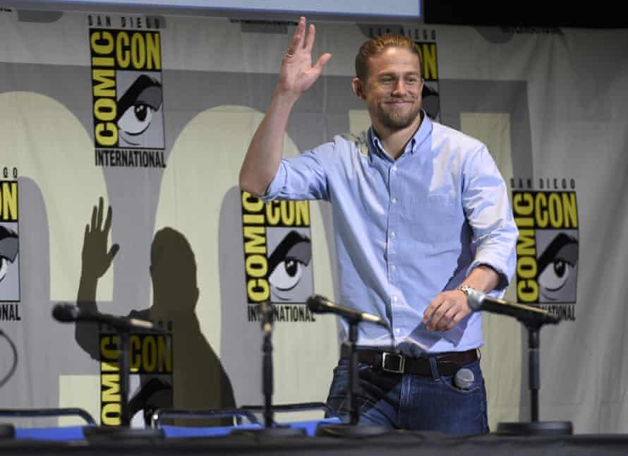 Charlie Hunnam walks on stage at the King Arthur: Legend of the Sword panel.