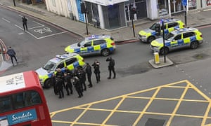 Police secure the area in Streatham after suspected terrorist was shot dead after a stabbing attack