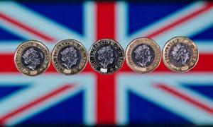 £1 coins across a Union flag