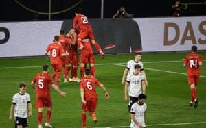 North Macedonia's forward Goran Pandev (hidden) celebrates scoring the opening goal with his teammates.