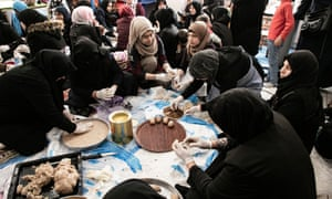 Syrian and Turkish women cook together at the Ensar community centre.