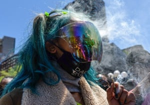 An activist smokes during the New York Cannabis Parade in support of the legalisation of marijuana