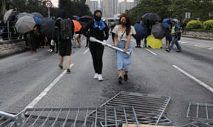 Anti-government protesters set up a barricade in Tai Po district in Hong Kong.