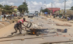 Demonstrators light a bonfire in Kasangati during protests in July sparked by the arrest of Uganda presidential hopeful for 2016 Amama Mbabazi, the former prime minister.