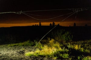 A damaged power line hangs near grass and shrubs as the sky is tinted orange by wildfire smoke in Clackamas County on September 9, 2020 in Oregon City, Oregon. Gov. Kate Brown declared a statewide emergency as blazes grew in several counties.