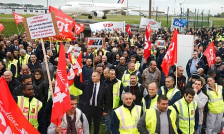 Striking Air France employees demonstrate in front of the company's headquarters.
