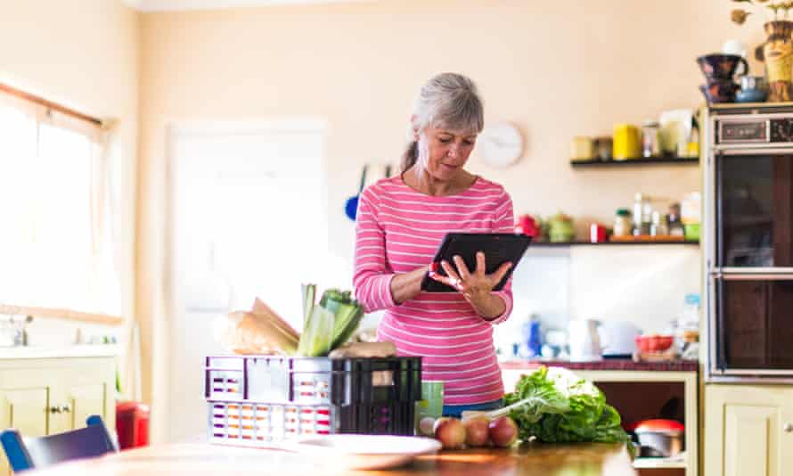 Senior woman checking her fresh vegetable delivery.