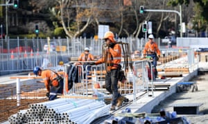 Construction workers build the Sydney Light Rail project in Sydney, New South Wales
