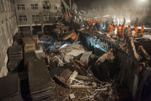 Wenling, China Rescuers looking for survivors in the debris of a collapsed building shoe factory