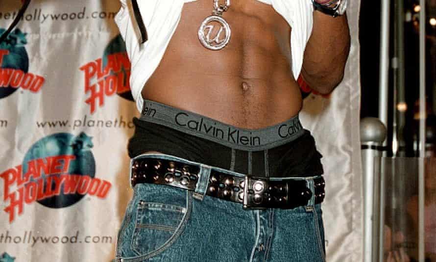 Usher shows his CK waistband.