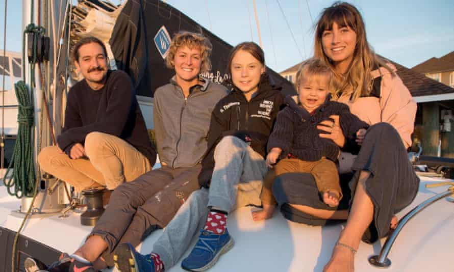 Swedish teen environmental activist Greta Thunberg posing on La Vagabonde with Riley Whitlum, Nikki Henderson, Elayna Carausu and their baby Lennon