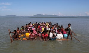 Rohingya refugees flee Myanmar on an improvised raft to reach to Bangladesh.