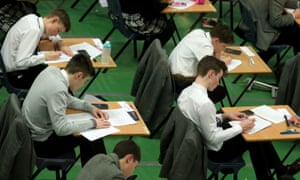 Students sitting an exam – the British system is skewed towards academic success.
