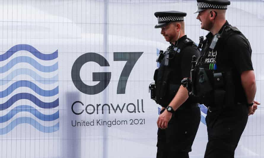 Two police officers at G7 summit.