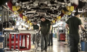 Employees at the Jaguar assembly plant in Castle Bromwich, where only a small part of its capacity is being used.