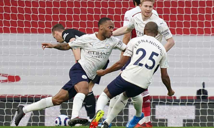 Raheem Sterling (left) wheels away to celebrate his early header which proved to be the winner against Arsenal.