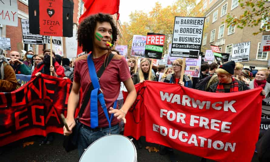 Students protesting against tuition fees, which make up part of the average undergrad debt of £50,000.