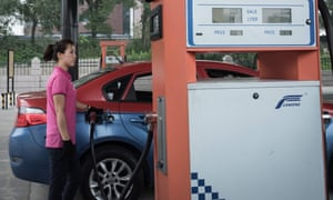 A petrol pump attendant fills up a taxi at a fuel station in Pyongyang.