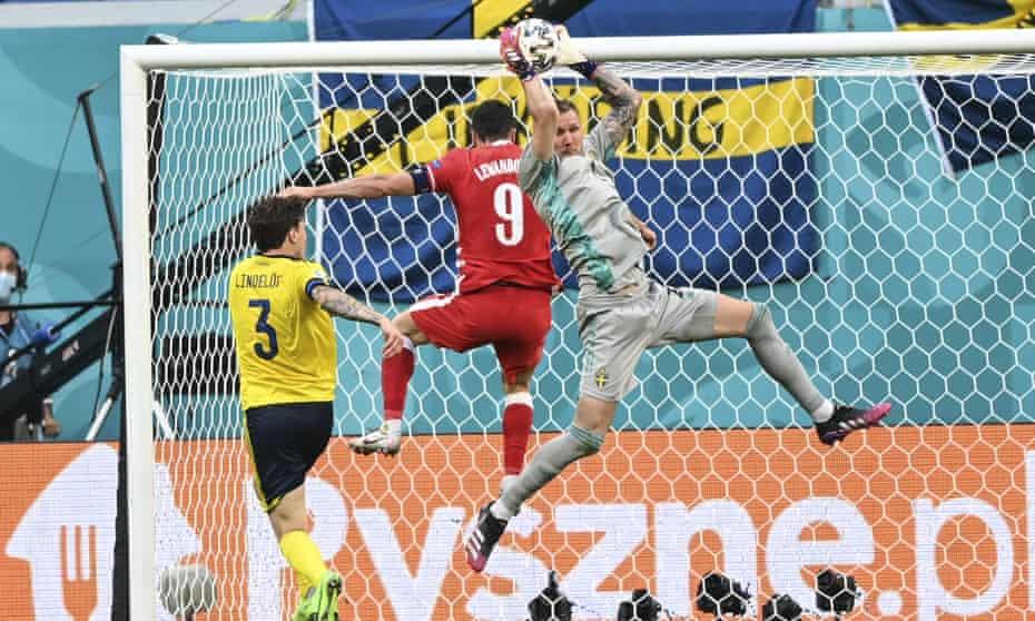 Sweden's Robin Olsen thwarts Poland striker Robert Lewandowski at Euro 2020.