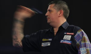 Gary Anderson gets his eye in during the PDC world championship final.