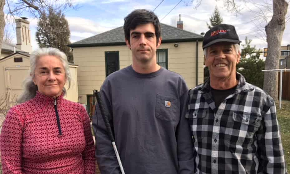 Ryan Partridge, 31, with his mother Shelley and father Richard. An episode of psychosis while in jail has left him permanently blind.