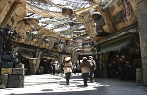 Characters stroll through the marketplace at the Black Spire Outpost