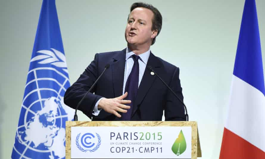David Cameron called for 'action today', not excuses tomorrow, on climate change in Paris. Back home, his ministers are rolling back on low-carbon policies.