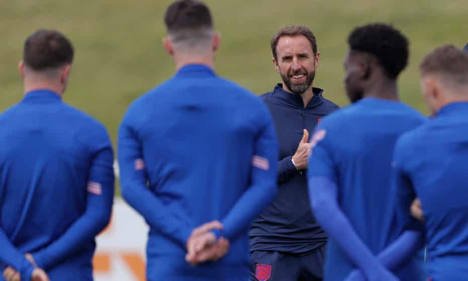 Gareth Southgate talks to his players at the start of training at St George's Park the day before their opening Euro 2020 match with Croatia.